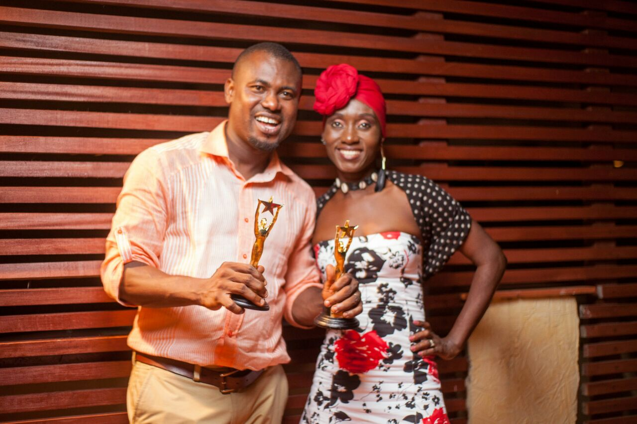 Abeiku Santana displays his awards with songstress, Nana Yaa
